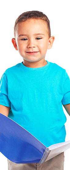 Preschool kid boy holding a notebook smiling at a Preschool & Daycare Serving Noblesville, IN