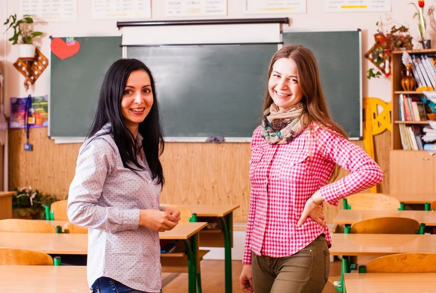 Two young women teacher standing in the middle of the classroom at a Preschool & Daycare Serving Noblesville, IN